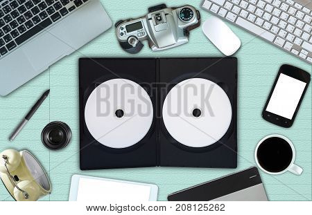 Top view of empty disk with cover and office accessory on paper background technology equipment mockup flat lay