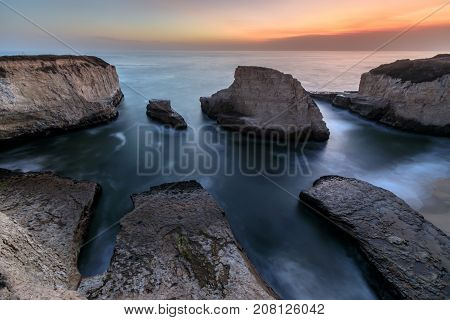 Dusk over Shark Fin Cove (Shark Tooth Beach). Davenport, Santa Cruz County, California, USA.