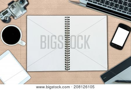 Top view of open leather book and office mockup technology equipment mockup flat lay