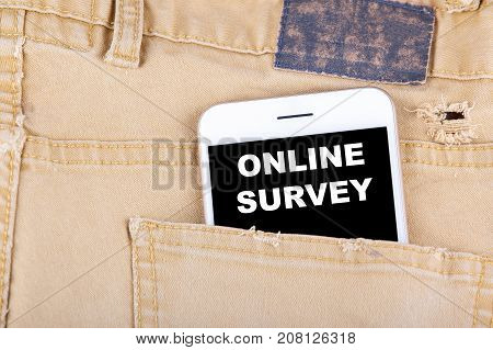 Online Survey. Smartphone in jeans pocket. Technology business and Review, Feedback Concept background.