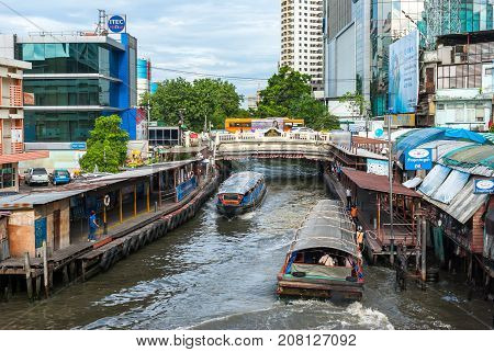 BANGKOK THAILAND - AUGUST 24: Undefined passenger people waiting and aboard to speed boat at Pratunam pier in Bangkok Water Canal Transportation by speed boat is one of the alternative choice for avoid the traffic congestion problem in BangkokThailand