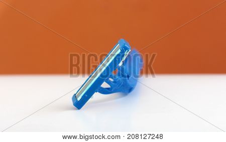 Used Shaving Razor On A White Brown Background