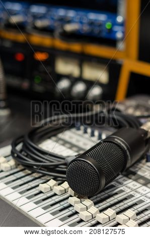 Close up of microphone with equipment on mixer in music studio music instrument concept