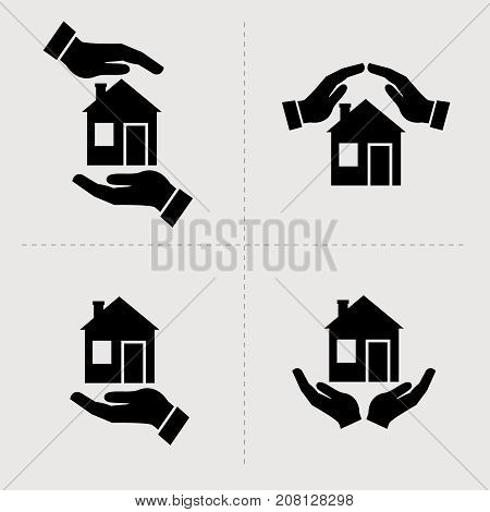 Save House icons. Houses in hands vector black icon set. Home repair and maintenance, insurance and security symbols