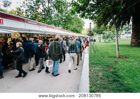 Madrid, Spain - May 1, 2017: A crowd of people in second hand book fair of Madrid