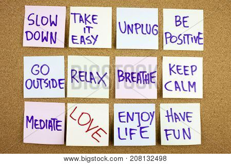 A Yellow Sticky Note Writing, Caption, Inscription Slow Down, Take Ir Easy Be Positive Go Outside Re