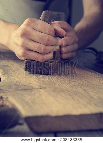 Wood working on an old oak plank close up shot joinery or carpentry background