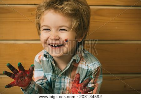 Boy Artist Happy Smiling On Wooden Wall