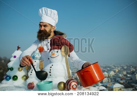 Hipster Smiling With Ladle In White Uniform