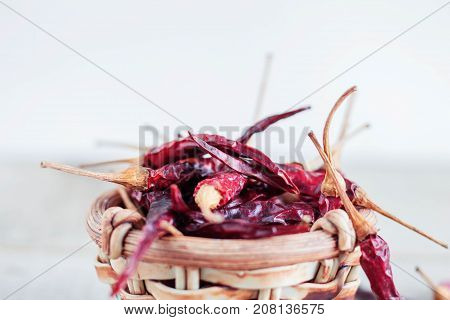 Dried chilli in a bowl on white background.