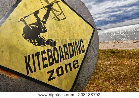 Kiteboarding area signal on a sandy beach. Extreme sport. Horizontal