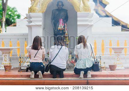 LAMPANG THAILAND - JULY 9 2017: Thai people worship Buddha statue at Wat Doi Pra Chan in Buddhist Lent festival on July 9 2017 in Lampang Thailand.