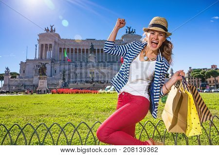 Cheerful Woman In Rome, Italy With Shopping Bags Rejoicing