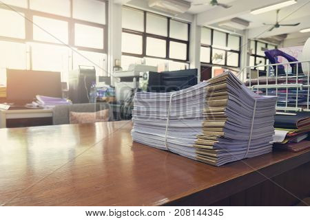 Business and finance concept of office working Pile of unfinished documents on office desk Stack of business paper