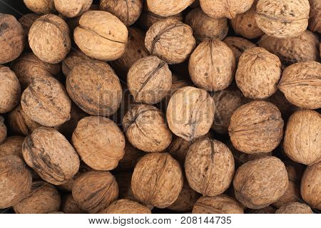 Scattered pile of walnuts, background, fresh walnuts market