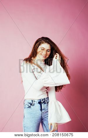 cute pretty redhair teenage girl smiling cheerful on pink background, lifestyle modern people concept close up