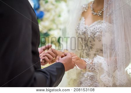 Newly wedding couple holding hands on hand