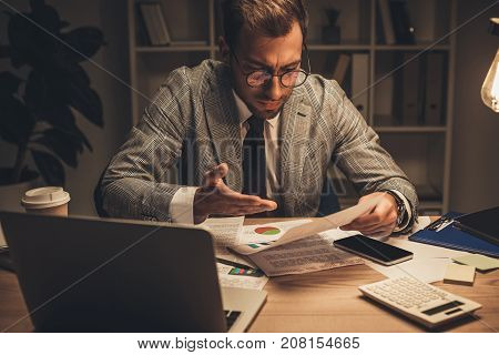 Overworked Businessman With Paperwork