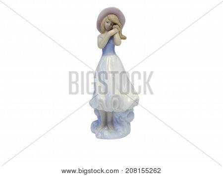 A ceramiric girl figurine in retro style over white