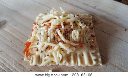 Puff pastry pizza snack close-up on wooden background