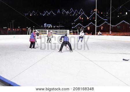 BUKOVEL, UKRAINE, March 06, 2017: hockey players play hockey on the ice rink in Bukovel, UKRAINE March 06 2017