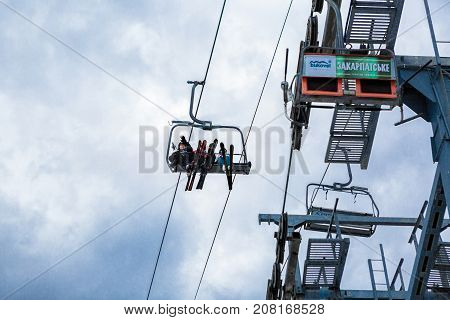 BUKOVEL, UKRAINE, March 06, 2017: skiers and snowboarders  lifting on ski-lift in the mountains in Bukovel, UKRAINE March 06 2017
