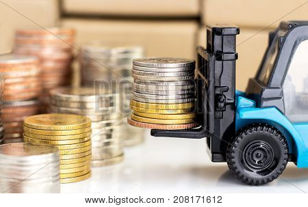 Coins stacked on the forklift truck. the concept of business growth financial or money savings