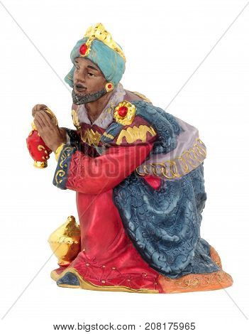 Christmas nativity King figure kneeling isolated on a white background