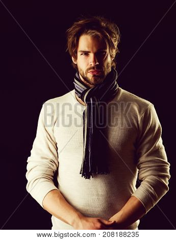 Bearded Macho With Tied Striped Scarf Looking Confidently