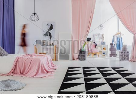 Woman's Bedroom With Pink Curtains