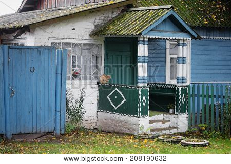 Porch Of A House In A Village On An Autumn Street.
