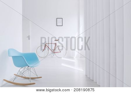 Blue Rocking Chair In Hall