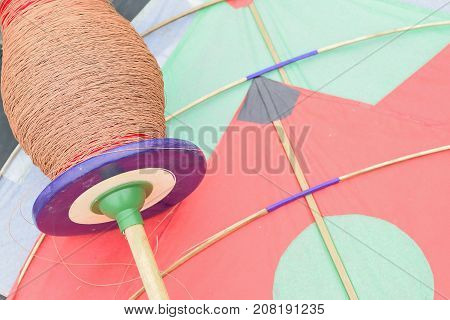 Background of colorful Indian Kite with threads called Manjha in horizontal frame
