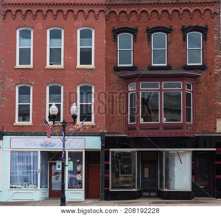 Seneca Falls New York USA -- Sept 30 2017 Red brick storefronts on Fall Street in Seneca Falls NY. Editorial Use Only.