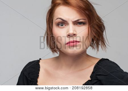 Women jealousy. Suspicion in adultery. Distrust in relationships, grumpy female mood on grey background. Personal life problems, suspicious concept