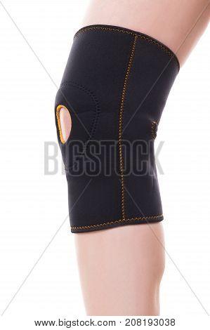 Female Leg With A Elastic Knee Bandage, Isolated On White