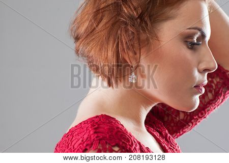 Life troubles. Hard times in relationships. Sad female after breakup closeup, upset girl on grey background with free space, depression concept