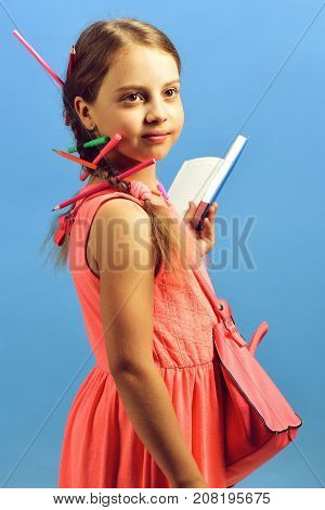 Back To School And Education Concept. Girl With Serious Face