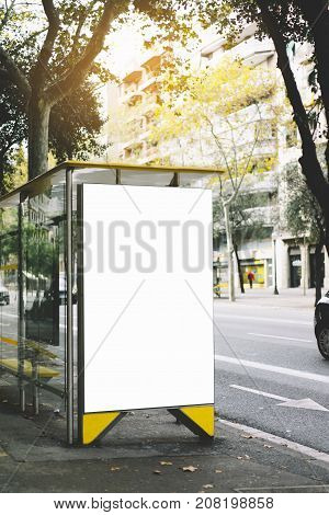 Blank advertising light box on bus stop mockup of empty ad billboard on sun day bus station template banner on background city street for poster or sign in Barcelona afisha board and taxi cars