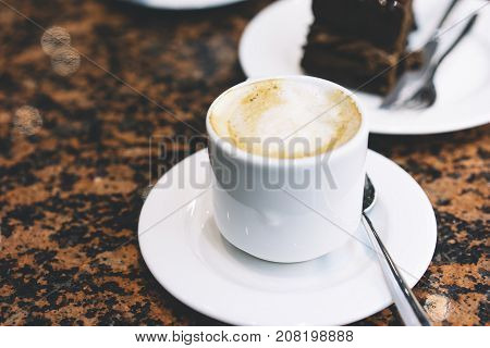 Close up drinking cup of hot aroma coffee isolated on the table in breakfast time morning sun day holiday relax concept