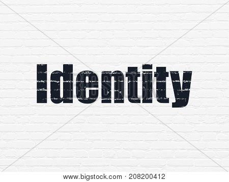 Privacy concept: Painted black text Identity on White Brick wall background