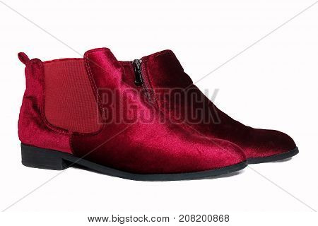 Lady's red ankle boots isolated on white background.