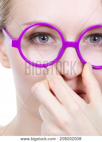 Stinky smells clogged concept. Nerdy woman in big funny glasses holding nose smelling bad scent