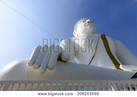 the white Buddha statute with the blue sky.