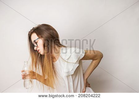 Problems with back, woman isolated on a white background