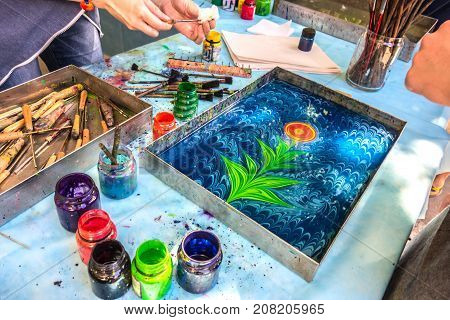 Moscow Russia - June 18 2017: Day of Turkey in Moscow. Cultural exchange between the two countries. Master class on the Turkish technique of painting ebru.