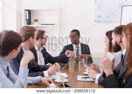 Manager with employees meeting, successful team with female boss. Office discussion, communication with partners at the desk