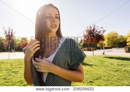 Happy smiling young woman,joyful face,enjoy life,in the autumn park