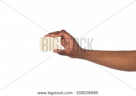 Banking services. Black male hand holding blank plastic credit card on white isolated studio background, copy space, cutout