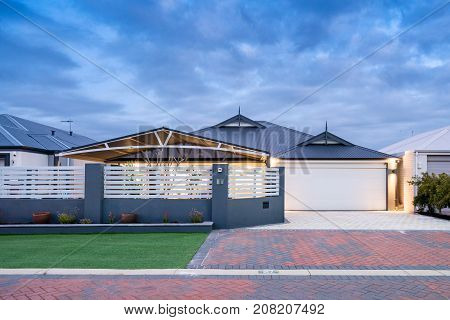 Front elevation of a modern Australian home at twilight. Perth, Western Australia.
